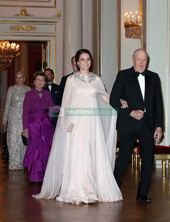 The Duchess of Cambridge is escorted into dinner by King Harald V of Norway at the Royal Palace, Oslo, Norway and the end of the third day of her tour of Scandinavia.