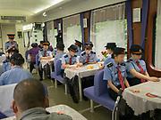 Staff meeting in the restaurant. The meetings are videotaped. Between Zhuzhou and Shangsha. Life in the train from Hong Kong to Urumqi (Xinjiang).
