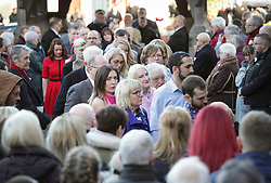 © Licensed to London News Pictures. 01/12/2017. Connah's Quay, UK. Guests wearing white ribbons arrive at the funeral of Carl Sargeant, who died four days after stepping down from his post in the Welsh Government after unspecified allegations of sexual harassment were made against him. He had denied the allegations. Photo credit: Joel Goodman/LNP