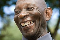 Older man laughing,