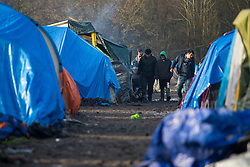 © Licensed to London News Pictures. 23/01/2016. Dunkirk, France. General view of the migrant camp in Dunkirk, northern France where Leader of the Labour Party JEREMY CORBYN is due to visits today (Sat). Thousands of migrants and refugees at living in temporary accommodation as they attempt to reach the UK. Photo credit: Ben Cawthra/LNP