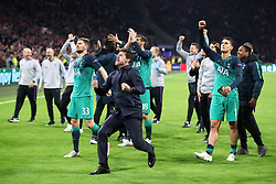 Tottenham Hotspur manager Mauricio Pochettino (centre) celebrates with team-mates after the final whistle during the UEFA Champions League Semi Final, second leg match at Johan Cruijff ArenA, Amsterdam.