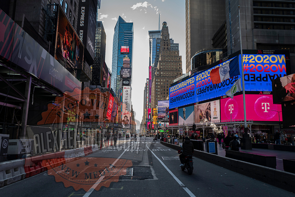 Shoppers and visitors walk in Times Square for the Holiday season during the Coronavirus (Covid-19) outbreak in Manhattan,New York on Sunday, December 6, 2020. (Alex Menendez via AP)
