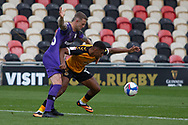 Newport County's Tristan Abrahams (11) under pressure from Tranmere Rover's Peter Clarke (26) during the EFL Sky Bet League 2 match between Newport County and Tranmere Rovers at Rodney Parade, Newport, Wales on 17 October 2020.