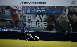 Groundskeepers tend to the grass during day one of the 2017 AEGON Championships at The Queen's Club, London. PRESS ASSOCIATION Photo. Picture date: Monday June 19, 2017. See PA story TENNIS Queens. Photo credit should read: Steven Paston/PA Wire. RESTRICTIONS: Editorial use only, no commercial use without prior permission, please contact PA Images for further info: Tel: +44 (0) 115 8447447.