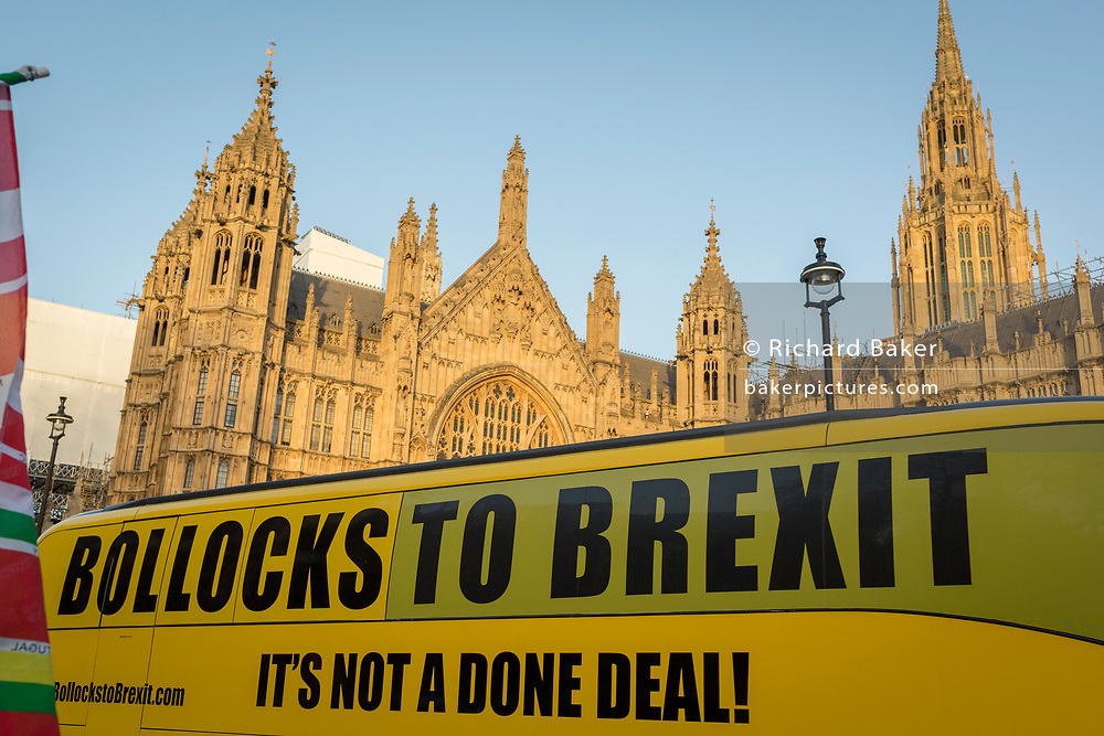 As Prime Minister Theresa May tours European capitals hoping to persuade foreign leaders to accept a new Brexit deal (following her cancellation of a Parliamentary vote), a pro-EU Remainer-sponsored bus drives past the protests opposite the Houses of Parliament, on 11th December 2018, in London, England.