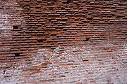 Characteristic red brickwork wall in Albi, Southern France.