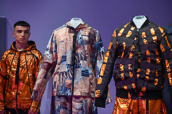 """© Licensed to London News Pictures. 17/10/2019. LONDON, UK. A model wears """"Mars clothing, SS20 New Horizons collection"""", by Raeburn. Preview of """"Moving to Mars"""" at the Design Museum. The exhibition explores how sending humans to Mars is a frontier for science as well as design and features over 200 exhibits from NASA, the European Space Agency together with new commissions.  The show is open 18 October to 23 February 2020.  Photo credit: Stephen Chung/LNP"""