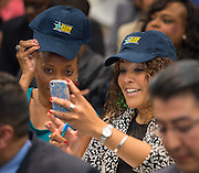 Principals display Team HISD hats they received as congratulations for helping the district win the Broad Prize for Urban Education during a school leadership meeting, October 2, 2013.
