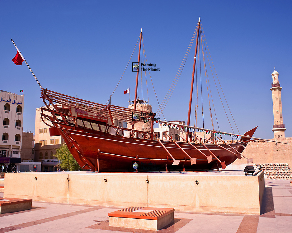 Traditional Arabic Dhow outside Dubai Museum. This is a fantastic example of the famous Dhow used up and down the Persian Gulf by traders, pearl divers and fishermen for centuries. <br /> <br /> The boat is constructed of wood through traditional methods, no nails or other modern materials are used in its construction. The boat is sealed by tapping string into the gaps between the planks. <br /> <br /> The boats are usually constructed be a father and son team who have passed their skills down through the generations. It is still possible to find these boats under construction along the Creek in Dubai but sadly there are only a few Dhow builders left as people opt for a more modern and cheaper solution.