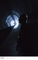 Line Describing a Cone (1973) by artist Anthony McCall is famous in the history of avant-garde film for its reduction of the cinematic experience to its core ingredients: projected light in physical space. For 30 minutes a beam of light from a 16mm film projector draws a perfect circle on a distant screen. In the space between, a solid cone takes shape as light particles cling to a haze filled room. Transforming the viewer's usual passive relation to the film medium, this work invites an active engagement with the cinematic experience.
