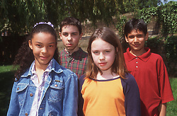 Multiracial group of children standing together in park,