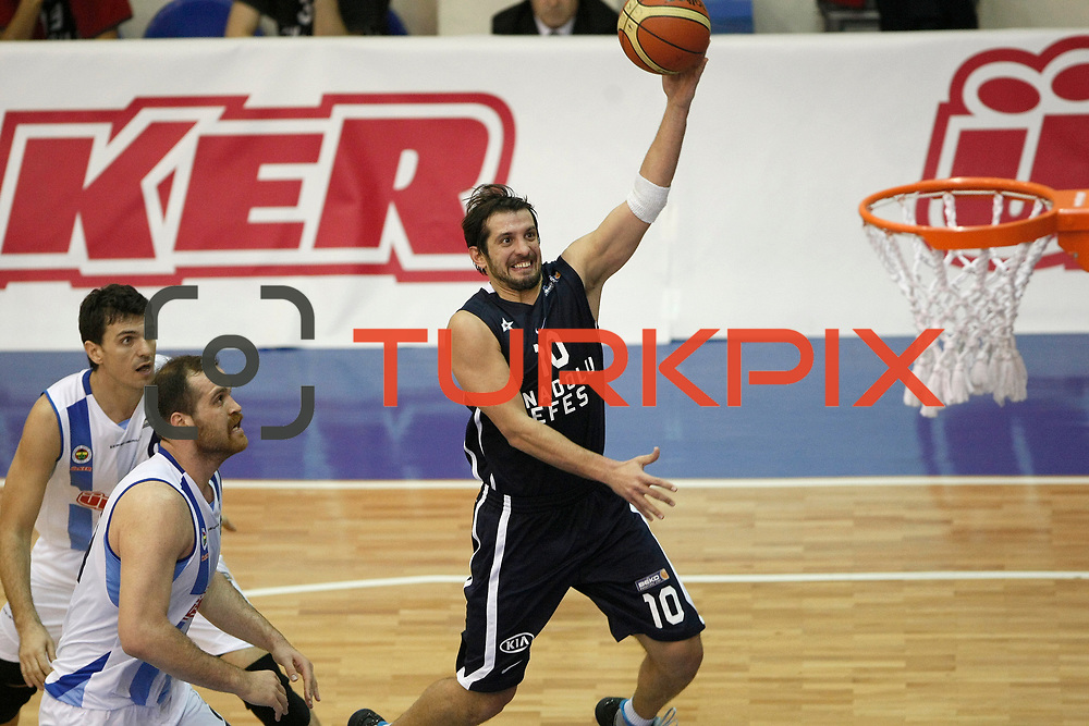 Anadolu Efes's Kerem Tunceri (C) during their Turkish Basketball league derby match  Fenerbahce Ulker between Anadolu Efes at Caferaga Sports Hall in Istanbul, Turkey, Saturday 01, 2012. Photo by TURKPIX