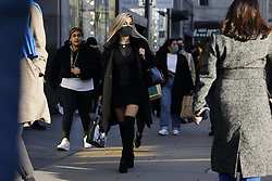 © Licensed to London News Pictures. 15/12/2020. London, UK. Shoppers look for bargains at Oxford Circus in London's West End. London and other areas of the south east are to enter tier three restrictions at midnight tonight as Covid-19 infection rates rise. Photo credit: Peter Macdiarmid/LNP