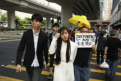 April 28, 2017 - Hong Kong, CHINA - Disqualified pro-HK independence lawmakers of the YOUNGSPIRATION, Baggio Leung ( L ) and Yau Wai-ching ( C ) cross the zebra after leaving the court today, charged with unlawful assembly and unlawful forced entry at LEGICO last November. 2017 Apr-28.Hong Kong.ZUMA/Liau Chung Ren (Credit Image: © Liau Chung Ren via ZUMA Wire)