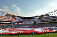 Fox Sports -- A general view as a stealth bomber performs a flyover during the playing of the national anthem before the 2012 MLB All Star Game at Kauffman Stadium..