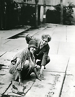 1927 Gloria Swanson with Sid Grauman in the forecourt of the Chinese Theatre