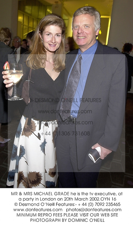 MR & MRS MICHAEL GRADE he is the tv executive, at a party in London on 20th March 2002.OYN 16
