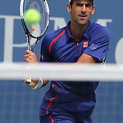 Novak Djokovic, Serbia, in action against Julien Benneteau, France, during the US Open Tennis Tournament, Flushing, New York. USA. 2nd September 2012. Photo Tim Clayton