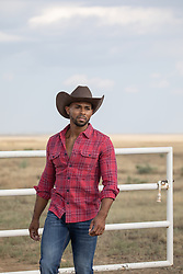 hot cowboy outdoors on a  ranch