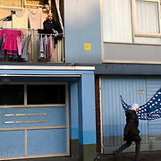 "Nederland Utrecht 31 januari 2009 20090131 Foto: David Rozing ..Serie vogelaarwijk Kanaleneiland .Reportage documentary on deprived area / projects "" Kanaleneiland "" This area is on a list with projects which need help of the government because of degradation in the area etc.Allochtone man haalt frisse neus op balkon, kleding buiten drogen op droogrek, in avondzon.Islamic man on balcony, laundry, going green.satelietschotel,satelietschotels, antenne,satelliet,sateliet,satelietontvanger,satellietontvanger,schotels,antenneschotel,antenneschotels,schotelantenne,schotelantennes,tv,ontvangst,communicatie,electronica,tv ontvangst,televisie ontvangst,.islam, islamic, project, suburb, suburbian, problem. Neighboorhood, neighboorhoods, district, city, problems, multicultural, immigrant, immigrants, cultural diversity, daily life..Foto David Rozing"