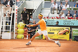 May 11, 2018 - Madrid, Madrid, Spain - RAFAEL NADAL reaches for the ball in a match against DOMINIC THIEM during the quarter finals of Mutua Madrid Open 2018 - ATP in Madrid. DOMINIC THIEM won the match 7-5(3) 6-3. (Credit Image: © Patricia Rodrigues via ZUMA Wire)