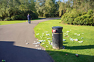 Waste on the ground around bin. Dulwich Park is a 30.85-hectare (76.2-acre) public park in Dulwich in the London Borough of Southwark, south London, England. The park was created by the Metropolitan Board of Works from former farmland and meadows. While the initial design was by Charles Barry, it was later refined by Lt Col J. J. Sexby. It was opened in 1890 by Lord Rosebery. The park is listed Grade II on the Register of Historic Parks and Gardens. Dulwich Park contains a café, boating lake and numerous sporting facilities. Various types of recumbent bicycles are available for hire.