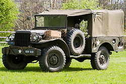 The Dodge WC51 was a 3/4 ton Light truck was designed in 1942. Models WC51 and WC52 were the same version of the vehicle but the model 52 had the addition of a 2.27 tonnes Braden winch at the front bumper. personal Produced in large numbers (123,541 were built) they were particularly prevalent throughout the Normandy campaign proving particularly suited to muddy roads. The open cab pick-up could be fitted with an M24A1 machine gun mount, which bolted across the front of the truck bed and could carry a Browning Automatic Rifle, M1919 Browning machine gun, or M2 Browning machine gun.<br /> <br /> 25 April  2015<br />  Image © Paul David Drabble <br />  www.pauldaviddrabble.co.uk