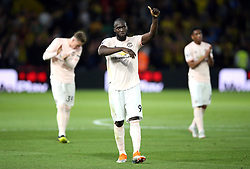 Manchester United's Romelu Lukaku (centre) applauds th fans after the final whistle during the Premier League match at Vicarage Road, Watford