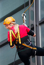 © licensed to London News Pictures. London, UK 14/05/2014. City traders and business people abseil off the Lloyd's building to raise funds for London-based international charity 'RedR' on Wednesday, 14 May 2014. Photo credit: Tolga Akmen/LNP