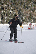 Italy, The Dolomites, winter December 2008 Young man at his first skiing lesson. Model Release Available