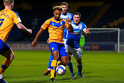 Nicky Maynard of Mansfield Town on the ball under pressure from John Rooney of Barrow - Mandatory by-line: Ryan Crockett/JMP - 27/10/2020 - FOOTBALL - One Call Stadium - Mansfield, England - Mansfield Town v Barrow - Sky Bet League Two