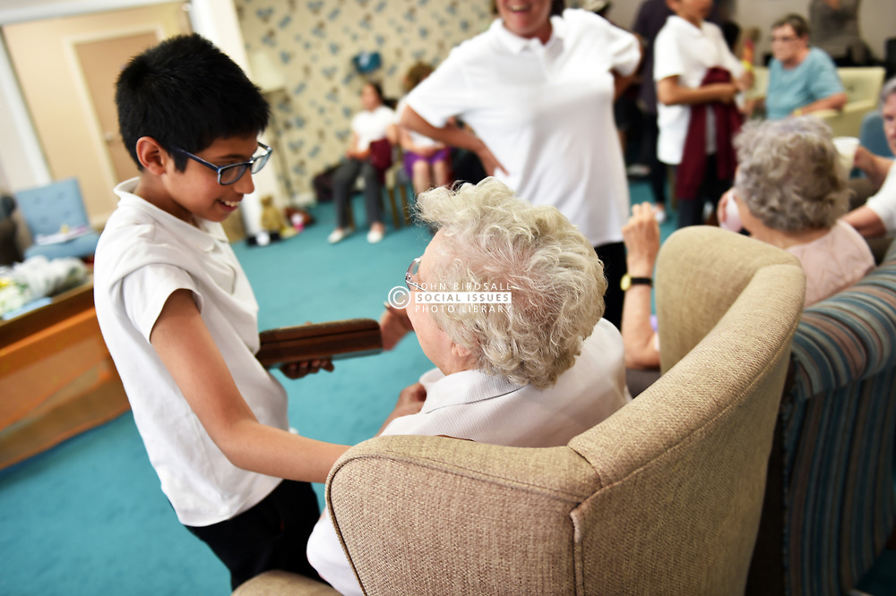 Generations mixing children elderly care home project intergeneration old young together happy school