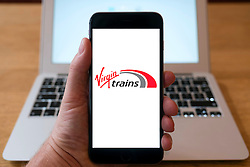 Virgin Trains railway company logo on website on smart phone screen.