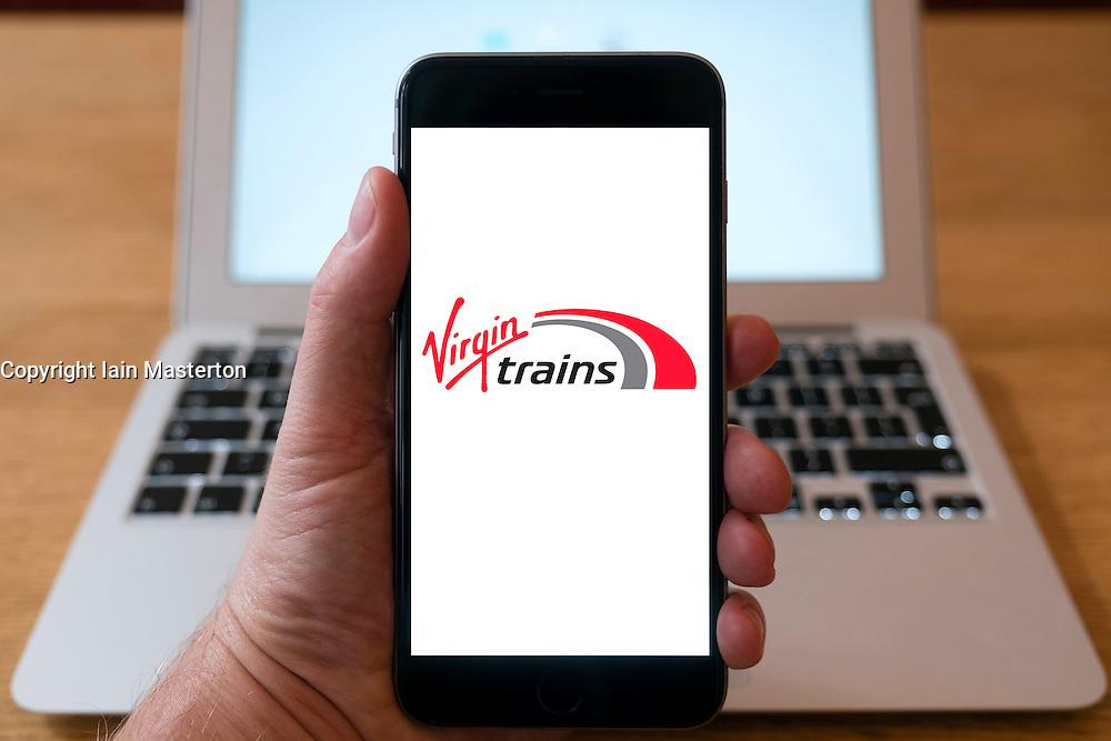 Virgin Trains railway company logo on website on smart phone screen.
