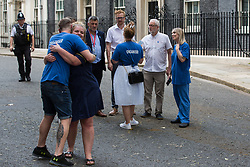 London, UK. 20th July, 2021. NHS Wales nurse Matthew Tovey celebrates with a fellow NHSPay15 campaigner after presenting his petition signed by over 800,000 people calling for a 15% pay rise for NHS workers at 10 Downing Street. At the time of presentation of the petition, the government was believed to be preparing to offer NHS workers a 3% pay rise in 'recognition of the unique impact of the pandemic on the NHS'.