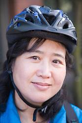 Portrait of a woman wearing a cycling helmet,