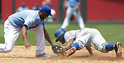 Kansas City Royals shortstop Alcides Escobar, left, is late with the tag as Texas Rangers Delino DeShields, right, safely steals second base in the third inning of a baseball game at Kauffman Stadium in Kansas City, Mo., Sunday, July 24, 2016. (AP Photo/Colin E. Braley)