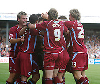 Photo: Steve Bond.<br />Scunthorpe United v Sheffield United. Coca Cola Championship. 01/09/2007. Andy Crosby (buried) is congratulated after scoring