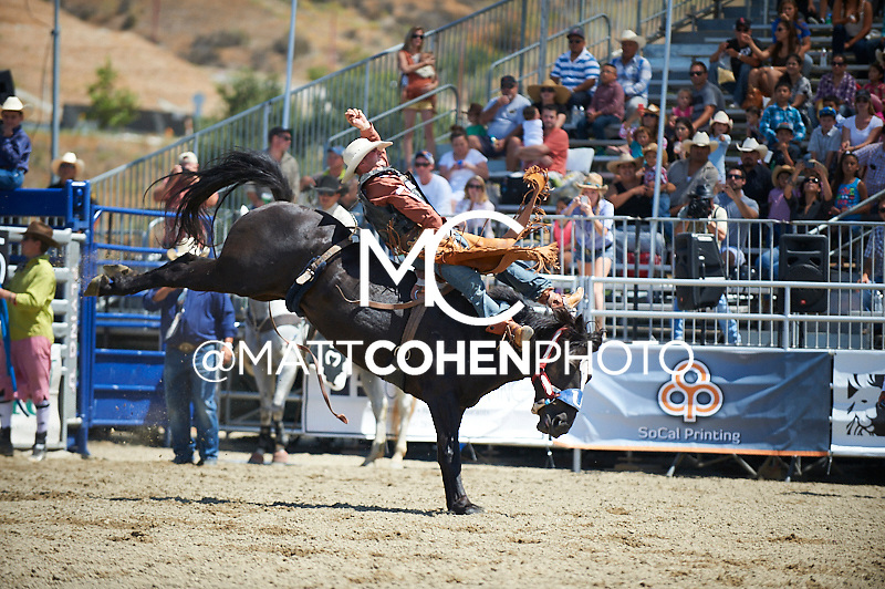 Bareback rider Steven Dent of Mullen, NE rides 779 Guilty Pleasure at the Rancho Mission Viejo Rodeo in San Juan Capistrano, CA.  <br /> <br /> <br /> UNEDITED LOW-RES PREVIEW<br /> <br /> <br /> File shown may be an unedited low resolution version used as a proof only. All prints are 100% guaranteed for quality. Sizes 8x10+ come with a version for personal social media. I am currently not selling downloads for commercial/brand use.