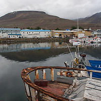 Dalvík is a small sleepy village with approximately 1800 residents, located in a very beautiful area, east of Eyjafjörður and close to the valley of Svarfaðardalur with a fantastic view on the hills. <br /> We arrived in Dalvík in the evening. As we entered in a hotel for asking for a cheap room, the owner suggested us a wooden house for a small extra charge. <br /> Built near the riverbank and with a nice veranda including a huge whirlpool, we agreed immediately. Our new friend was very polite and helping! He gave us also the key for the hotel, because he had to leave the village for a couple of hours, and for the case, if we would like to play billard in the mainroom. Later at night, we all played billard and drunk some beers together with the owner.
