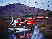 Lake Clark Air Service's de Hvilland DHC3 Otter picking up hunting party from the shore of Pear Lake, Lake Clark National Preserve, Alaska.