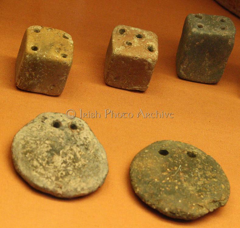 Six loon-weights, three disc-shaped and three cubes. Minoan 2100-1450 BC Found at Petras and Palaikastro