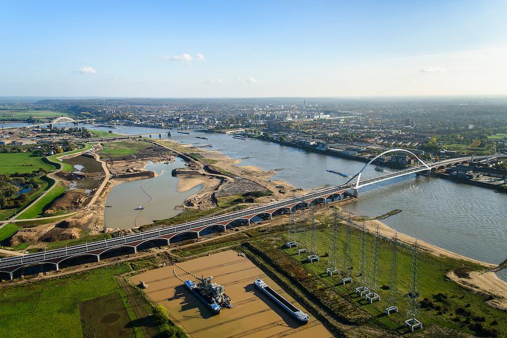 Nederland, Gelderland, Nijmegen, 24-10-2013; <br /> De nieuwe stadsbrug van Nijmegen, De Oversteek.<br /> grondwerkzaamheden voor de dijkteruglegging Lent (Ruimte voor de Rivier). De dijken worden landinwaarts verplaatst en er wordt een nevengeul voor rivier de Waal gegraven. <br /> irst bridge the new city bridge of Nijmegen on the river Waal, De Oversteek (The Crossing). Next the railway bridge with cycle path De Snelbinder (The Luggage strap) and finally the Waal bridge. Right the groundworks for the Dike relocation of Lent (project Ruimte voor de Rivier: Room for the River). <br /> luchtfoto (toeslag op standaard tarieven);<br /> aerial photo (additional fee required);<br /> copyright foto/photo Siebe Swart.