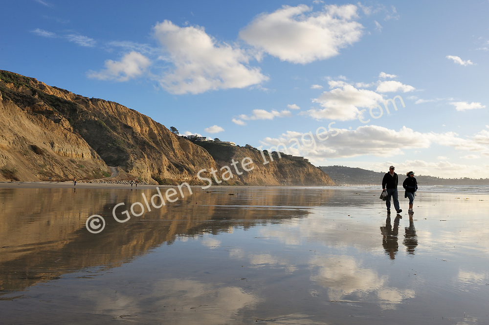 Couple walking along tidal flats. Southern end of Blacks looking south to La Jolla. (Not Model Released)