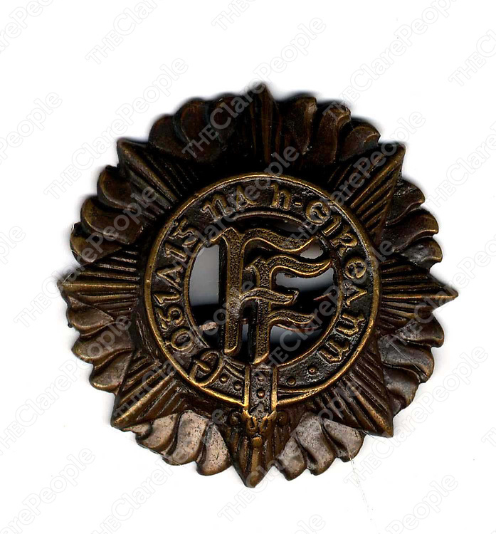 The Cap Badge worn by Michael Collins, on his Irish Free State issued uniform, when he was shot at Beal na Blath