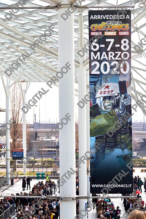 Milan, Italy - March 8 2019 Cartoomics Comic Con Visittors line for passing security check in RHO fiera Milano