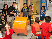 """Fourth-grade teacher Robert Bonn in his classroom at Twain Elementary, October 1, 2013. Bonn was awarded school supplies valued at $1000 by OfficeMax as part of the """"A Day Made Better"""" program."""