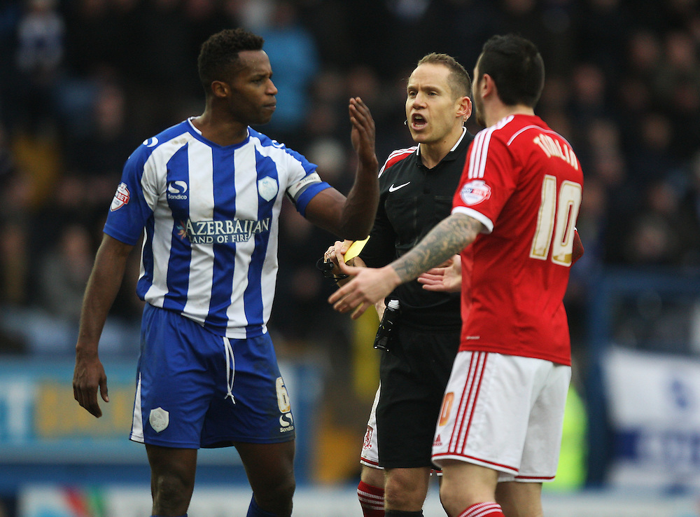 Sheffield Wednesday's Jose Semedo (L) and Middlesbrough's Lee Tomlin (R) clash during the match<br /> <br /> Photographer Jack Phillips/CameraSport<br /> <br /> Football - The Football League Sky Bet Championship - Sheffield Wednesday v Middlesbrough - Saturday 28th February 2015 - Hillsborough - Sheffield<br /> <br /> © CameraSport - 43 Linden Ave. Countesthorpe. Leicester. England. LE8 5PG - Tel: +44 (0) 116 277 4147 - admin@camerasport.com - www.camerasport.com