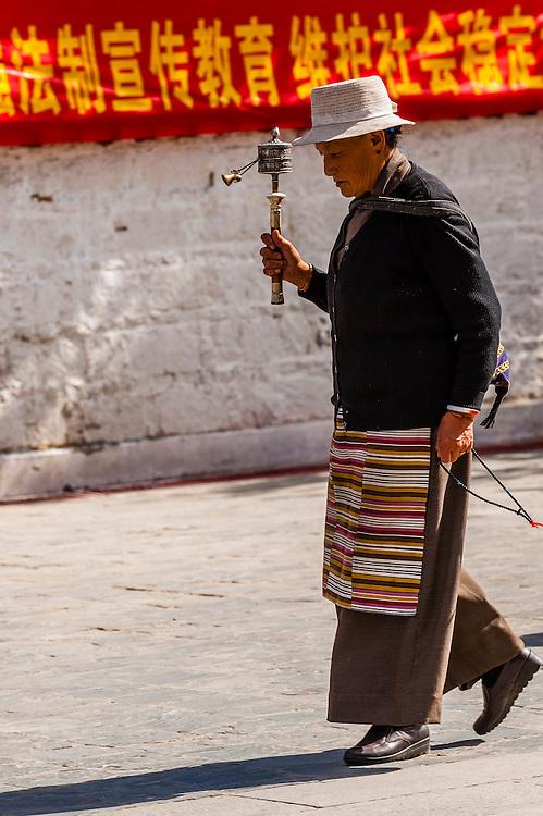 Tibetan pilgrims circumambulating through Barkhor Square and along The Barkhor Tibet (the route around the Jokhang Temple), Old Lhasa,  (Xizang), China.
